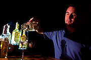 Clayton Szczech, owner of Experience Tequila, a tequila region tourism company, pours a glass of Fortaleza tequila in the company's tasting room. Fortaleza, founded by a descendant of the Sauza family, is considered the finest tequila in the world.