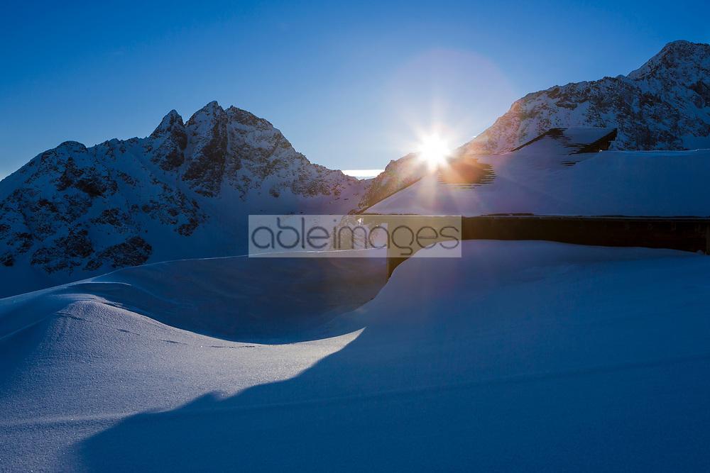 Sunrise over Snow covered Mountains, St Moritz, Switzerland