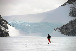 © Licensed to London News Pictures. Union Glacier, Antarctica. PETR VABROUSEK competing in the 9th edition of the Antarctic Ice Marathon, which he won in record time. The Ice Marathon took place at Union Glacier, Antarctica, and is  recognised as the world's southernmost marathon and the only official running event within the <br /> Antarctic Circle, taking place just a few hundred miles from the South Pole at the foot of the Ellsworth Mountains. Temperatures were an ice cool -21C when the event got underway at 13:10 GMT on Wednesday 20 <br /> November. A total of 56 athletes from 21 countries took part in the ninth edition of the event, which is  an essential race for marathon runners seeking to join the Seven Continents Marathon Club. Photo credit: Mike King/LNP