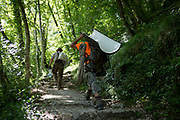 A worker carries materials in the forest at Tolmin Gorge Tolminska Korita, on 20th June 2018, in Tolmin Gorge , Slovenia.