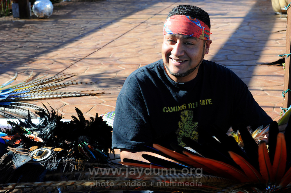 """Victor Juarez, one of the founders of Yaocuauhtli, preparing for a unique """"xilonen"""" coming-of-age ritual for Josselyn Melanie Cuauhyolotzin at the Salinas home of her parents. Dancers from throughout the Aztec community in California came together on Saturday, February 9th, 2013, to celebrate her passage from childhood to maidenhood. The ritual is one of the spiritual bases in Mexican tradition for the """"quinceanera."""""""