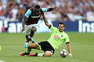 Charlie Daniels of AFC Bournemouth tackles Michail Antonio of West Ham United. Premier league match, West Ham Utd v AFC Bournemouth at the London Stadium, Queen Elizabeth Olympic Park in London on Sunday 21st August 2016.<br /> pic by John Patrick Fletcher, Andrew Orchard sports photography.