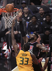 November 30, 2017 - Los Angeles, California, United States of America - Willie Reed #35 of the Los Angeles Clippers tries to block a shot from Ekpe Udoh #33 of the Utah Jazz on Thursday November 30, 2017 at the Staples Center in Los Angeles, California. Clippers lose to Jazz, 126-107. JAVIER ROJAS/PI (Credit Image: © Prensa Internacional via ZUMA Wire)
