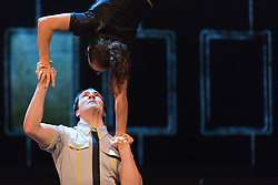 """© Licensed to London News Pictures. 30/09/2013. London, England. Pictured: Justine Méthé-Crozat and Jérémy St-Jean. The 15 performers from the Canadian troupe Cirque Éloize perform their show """"iD"""" at London's Peacock Theatre from 1 to 19 October 2013. """"iD"""" is a blend of circus arts and urban dance. Photo credit: Bettina Strenske/LNP"""