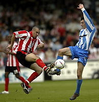 Photo Aidan Ellis, Digitalsport<br /> NORWAY ONLY<br /> <br /> Lincoln City v Huddersfield Town.<br /> Third Divison Play Off Semi Final 1st leg.<br /> 15/05/2004.<br /> huddersfield's Andy Holdsworth (right) and Lincoln's Gary Fletcher