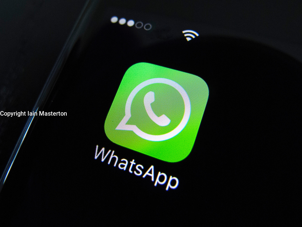 WhatsApp social media messaging app icon on screen of iPhone