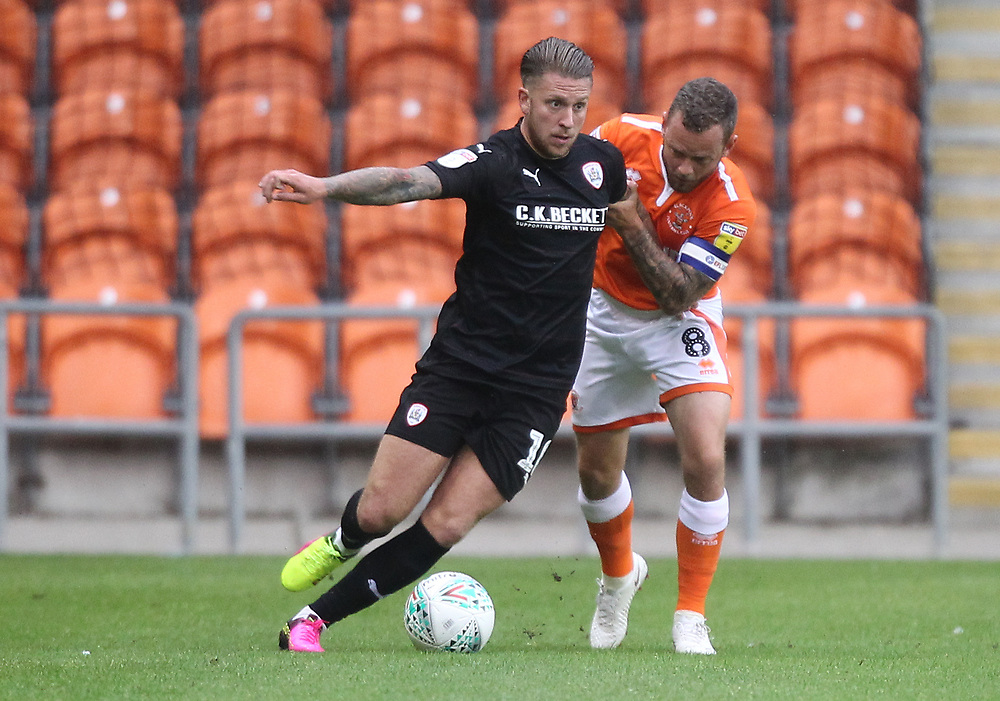 Blackpool's Jay Spearing  battles with Barnsley's George Moncur<br /> <br /> Photographer Mick Walker/CameraSport<br /> <br /> Carabao Cup First Round - Blackpool v Barnsley - Tuesday August 14th 2018 - Bloomfield Road - Blackpool<br />  <br /> World Copyright © 2018 CameraSport. All rights reserved. 43 Linden Ave. Countesthorpe. Leicester. England. LE8 5PG - Tel: +44 (0) 116 277 4147 - admin@camerasport.com - www.camerasport.com