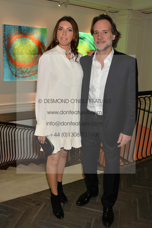 PAUL GREEN President of Halcyon Gallery and his wife KATIE GREEN at a private view of work by artist Dale Chihuly: Beyond the Object was held at The Halcyon Gallery 144-146 New Bond Street, London on 5th February 2014.