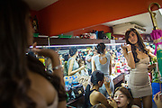 """18 JANUARY 2013 - BANGKOK, THAILAND: A transgendered sex worker gets ready for her shift in a dressing room in the Nana Entertainment District in Bangkok. Prostitution in Thailand is technically illegal, although in practice it is tolerated and partly regulated. Prostitution is practiced openly throughout the country. The number of prostitutes is difficult to determine, estimates vary widely. Since the Vietnam War, Thailand has gained international notoriety among travelers from many countries as a sex tourism destination. One estimate published in 2003 placed the trade at US$ 4.3 billion per year or about three percent of the Thai economy. It has been suggested that at least 10% of tourist dollars may be spent on the sex trade. According to a 2001 report by the World Health Organisation: """"There are between 150,000 and 200,000 sex workers (in Thailand).""""          PHOTO BY JACK KURTZ"""