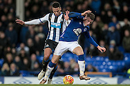 Ross Barkley (Everton) is tackled by Jamaal Lascelles (Newcastle United) who gives away a second penalty during the Barclays Premier League match between Everton and Newcastle United at Goodison Park, Liverpool, England on 3 February 2016. Photo by Mark P Doherty.