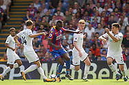 Christian Benteke of Crystal Palace © under pressure from Federico Fernandez, Sam Clucas, Tom Carroll and Kyle Naughton of  Swansea City .<br /> Premier League match, Crystal Palace v Swansea city at Selhurst Park in London on Saturday 26th August 2017.<br /> pic by Kieran Clarke, Andrew Orchard sports photography.