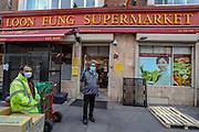 The entry health checker of the Loon Fung Chinese supermarket on Gerrard Street in London's Chinatown district pose to show temperature device, which he uses to check Supermarket's Customers before they enter the shop to help curb the spread of Coronavirus outbreak on Monday, May 4, 2020. <br /> What started as an epidemic mainly limited to China has now become a truly global pandemic. Outside of China, there have been over 3,402,126 cases and over 247,107 deaths, according to the John Hopkins University Covid-19 dashboard, which collates information from national and international health authorities. The disease has been detected in at least 187 countries and territories, with Italy, Iran, Spain and the US lately experiencing the most widespread outbreaks outside of China. In the UK, there have been 186,599 confirmed cases and 28,446 deaths until the 3rd of May. (Photo/ Vudi Xhymshiti)