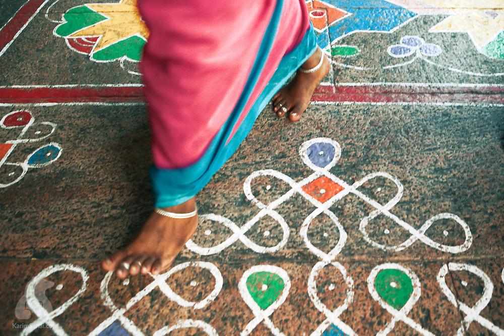 A woman walks on the decorated floor of the Shri Minakshi hindu temple.