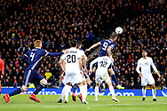Scotland forward Steven Fletcher (9) (Sheffield Wednesday) wins the header from the corner  during the UEFA Nations League match between Scotland and Israel at Hampden Park, Glasgow, United Kingdom on 20 November 2018.