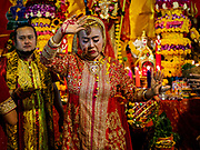 19 OCTOBER 2018 - BANGKOK, THAILAND: A woman leads a blessing ceremony during Navratri observances in Bangkok. Navratri is a nine night (10 day) long Hindu celebration that marks the end of the monsoon and honors of the divine feminine Devi (Durga). The festival is celebrated differently in different parts of India, but the common theme is the battle and victory of Good over Evil based on a regionally famous epic or legend such as the Ramayana or the Devi Mahatmya. Navratri is celebrated throughout Southeast Asia in communities that have a large Hindu population. Because Navratri honors the feminine Devi, Navratri is especially popular with Thai women and transgendered people.   PHOTO BY JACK KURTZ