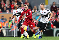 Fulham's (left-right) Denis Odoi, Liverpool's Xherdan Shaqiri and Fulham's Calum Chambers battle for the ball during the Premier League match at Anfield, Liverpool.