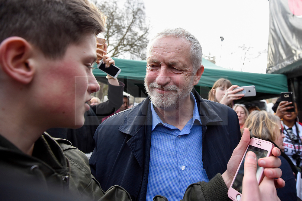 "© Licensed to London News Pictures. 04/03/2017. London, UK. Jeremy Corbyn, Labour leader, meets a young fan ahead of addressing thousands taking part in a ""Save the NHS"" rally.  The demonstrators marched from Tavistock Square to Parliament Square protesting against funding cuts. Photo credit : Stephen Chung/LNP"