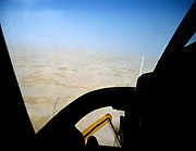 View from helicopter cockpit over desert, Saudi Arabia  1979