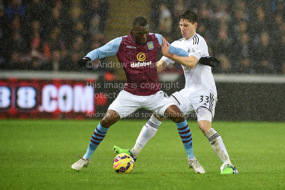 Christian Benteke of Aston Villa holds off Swansea's Federico Fernandez . Barclays Premier league match, Swansea city v Aston Villa at the Liberty stadium in Swansea, South Wales on Boxing Day, Friday 26th December 2014<br /> pic by Andrew Orchard, Andrew Orchard sports photography.