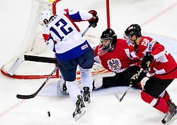 David Rodman of Slovenia vs Fabian Weinhandl of Austria and Martin Schumnig of Austria during ice-hockey match between Austria and Slovenia of Group G in Relegation Round of IIHF 2011 World Championship Slovakia, on May 7, 2011 in Orange Arena, Bratislava, Slovakia. Austria defeated Slovenia 3-2. (Photo By Vid Ponikvar / Sportida.com)