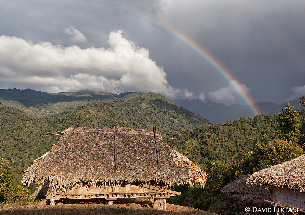 Bamboo hut under a rainbow, seen while walking from Komsing to Karo.
