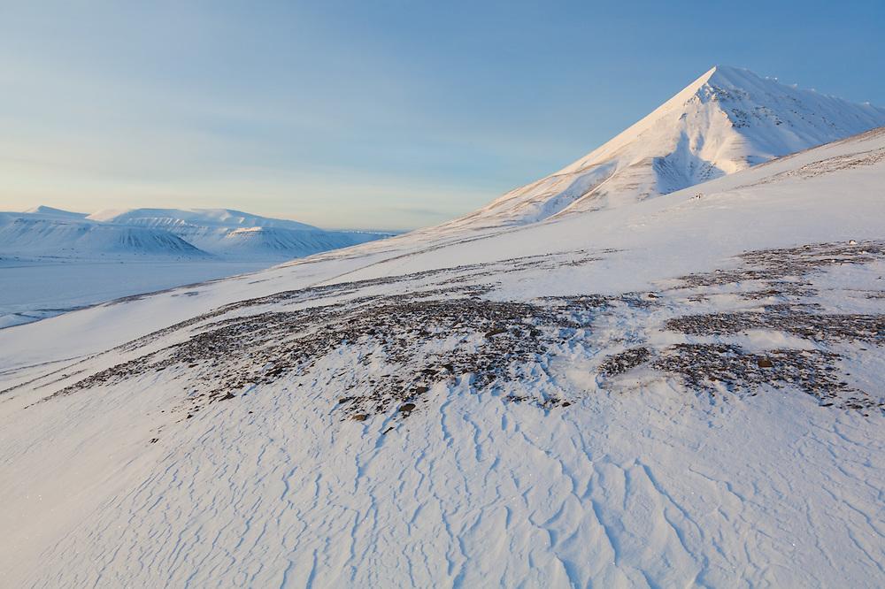 Windswept snow on a hillside in Koslådalen, Svalbard.