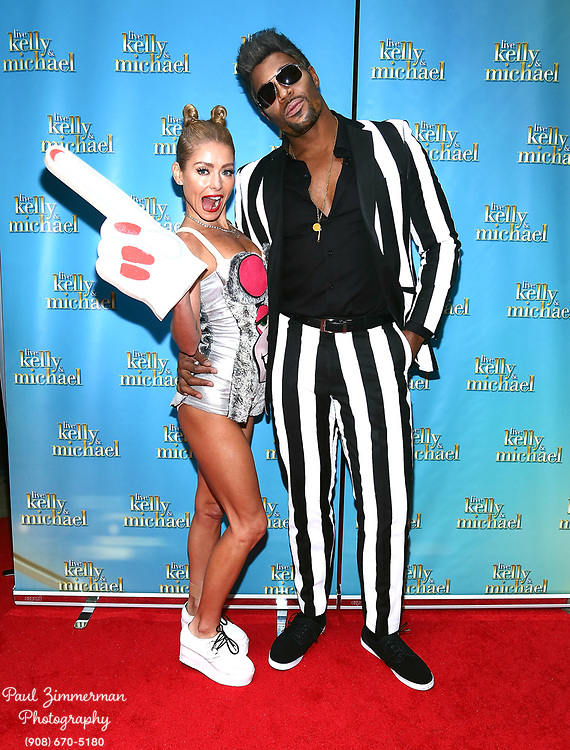 """NEW YORK, NY - OCTOBER 31:  Kelly Ripa (L) and Michael Strahan attend the """"LIVE with Kelly and Michael"""": Best Halloween Show Ever at Live with Kelly And Michael Studio on October 31, 2013 in New York City.  (Photo by Paul Zimmerman/WireImage)"""