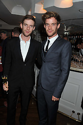 Left to right, LUKE TREADAWAY and HARRY TREADAWAY at Shepherd's Delight an evening of Dinner & Entertainment in aid of The National Youth Theatre of Great Britain held at Shepherd's, Marsham Street, London on3rd December 2012.