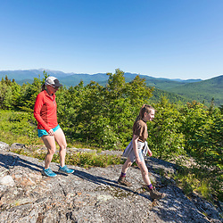 Hikers with Mount Washington in the distance in Jackson, New Hampshire. White Mountains.
