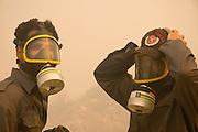 Two men wearing gas masks