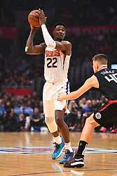 February 13, 2019 - Los Angeles, CA, U.S. - LOS ANGELES, CA - FEBRUARY 13: Phoenix Suns Center DeAndre Ayton (22) looks to make a pass during a NBA game between the Phoenix Suns and the Los Angeles Clippers on February 13, 2019 at STAPLES Center in Los Angeles, CA. (Photo by Brian Rothmuller/Icon Sportswire) (Credit Image: © Brian Rothmuller/Icon SMI via ZUMA Press)