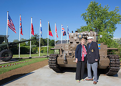 """© Licensed to London News Pictures. 29/05/2014. Sid and Jean Williams stand in front of one of the only two remaining British Centurion tanks that were used in the landings.  Sid, now 93 drove one of the tanks during the landings on Juno beach and this is the first time he has seen one since the war.  """"We have to waterproof everything.  We got dropped in the sea and drove up the beaches.  All we could see were people dyeing all around us.""""  Commented Sid as he reminisced on the landings.   . Photo credit : Alison Baskerville/LNP"""