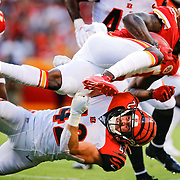 KANSAS CITY, MO - AUGUST 10: Tremon Smith #20 of the Kansas City Chiefs is tackled on a kick return by Clayton Fejedelem #42 of the Cincinnati Bengals in the first quarter at Arrowhead Stadium on August 10, 2019 in Kansas City, Missouri. (Photo by David Eulitt/Getty Images)