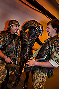 Fans of the fantasy film Alien (Alien is a 1979 science fiction horror film directed by Ridley Scott) attending the London Film and Comic Con LFCC is a convention held annually in London that focuses on films, cult television and comics. The convention holds a large dealers hall selling movie, comic and science fiction related memorabiliaand original film props, along with free guest talks, professional photoshoots, autograph sessions, displays. Many of the visitors / attendeesarrive dressed up as their favourite comic and sci-fi characters in the most outlandish costumeswhich draws from the award-winning formula of innovative gameplay.