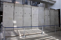 February 6, 2018 - Washington, DC, U.S - Seen here is a concrete segment of the Berlin Wall that is preserved in the Newseum in Washington, DC.  This image shows the eight 12-foot tall concrete sections from the East Berlin side, which is almost bare of markings (as opposed to the segment seen from the West Berlin side).  Using August 13th, 1961 as the ''start'' of the Berlin Wall, and November 9th, 1989 as the ''fall'' of the wall, the Berlin Wall has now been ''down'' longer than it was ''up'' in Germany. (Credit Image: © Evan Golub via ZUMA Wire)