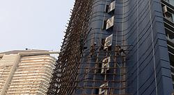 October 9, 2018 - Hong Kong, CHINA - A bamboo scaffolding engineers ( workers ) constructing bamboo scaffoldings along outer wall of a hotel awaiting to be demolished. Hong Kong is a place where old skill of bamboo scaffolding is kept as Chinese traditional architectural craft. Oct-9,2018 Hong Kong.ZUMA/Liau Chung-ren (Credit Image: © Liau Chung-ren/ZUMA Wire)