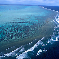 Australia, Great Barrier Reef, Aerial view of South Pacific Ocean and Heron Island off the Queensland coast