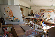 Palace of Culture Theatre prop room with paintings of Lenin and dignitories.