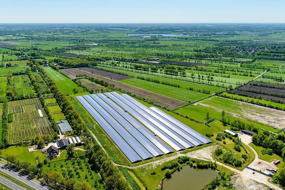 Nederland, Friesland, gemeente Tietjerksteradeel, 07-05-2018; Garyp, een van de eerste en grootste zonneparken van Nederland, gerealiseerd op een voormalige vuilstortplaats. Het zonnepark is een initiatief van bewoners verenigd in 'Enerzjy Koöperaasje Garyp'<br /> Garyp, small village in North-Friesland. One of the first and largest solar parks in the Netherlands, realized on a former landfill. The solar park is an initiative of the residents.<br /> luchtfoto (toeslag op standard tarieven);<br /> aerial photo (additional fee required);<br /> copyright foto/photo Siebe Swart