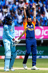 Mohammed Shami of India celebrates taking the wicket of a dejected looking Joe Root of England - Mandatory by-line: Robbie Stephenson/JMP - 30/06/2019 - CRICKET - Edgbaston - Birmingham, England - England v India - ICC Cricket World Cup 2019 - Group Stage