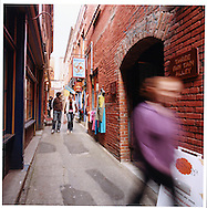 Just half a block from the golden lions of the Gates of Harmonious Interest lays Fan Tan Alley, the very heart of Canada's oldest Chinatown. The high brick walls of this site have been deeply etched with the rich cultural history of North America's immigrant Chinese..The alleyway's weather-worn red bricks have remained almost unchanged since Chinatown's earliest times. Fan Tan Alley is an alley in Victoria, British Columbia's Chinatown. It was originally a gambling district with restaurants, shops, and opium dens. Today it is a tourist destination as it contains many small shops. It is most famous for being the narrowest street in Canada. At its narrowest point it is only 0.9 metres wide.