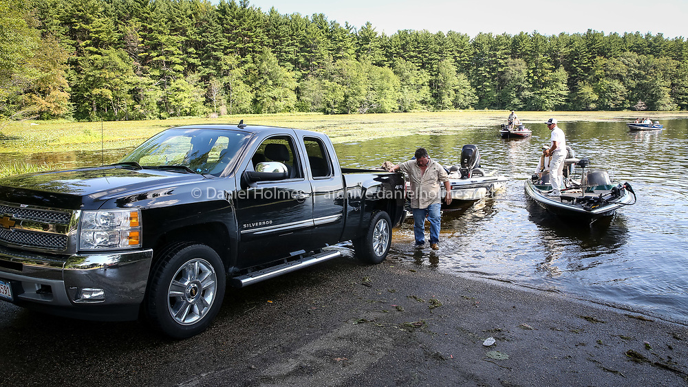 (8/16/15, HOPKINTON, MA) Fishermen trailer their boats for the weigh-in for the Mass Bass TBF Open fishing tournament at White Hall Reservoir in Hopkinton on Sunday. Daily News and Wicked Local Photo/Dan Holmes