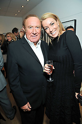 ANDREW NEIL and Grania Stevenson at a private view of photographs by Marina Cicogna from her book Scritti e Scatti held at the Little Black Gallery, 3A Park Walk London SW10 on 16th October 2009.