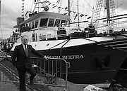 "The 1989 Boat Show.   (R89)..1989..10.03.1989..03.10.1989..10th March 1989..Pat the Cope GallagherTD, Minister for the Marine attended the opening of the 1989 Boat Show held at the Point Depot, Dublin. The opening coincided with the minister's birthday...The Minister for the Marine, Pat the Cope Gallagher is pictured alongside the fishing vessel ""Lough Beltra""."