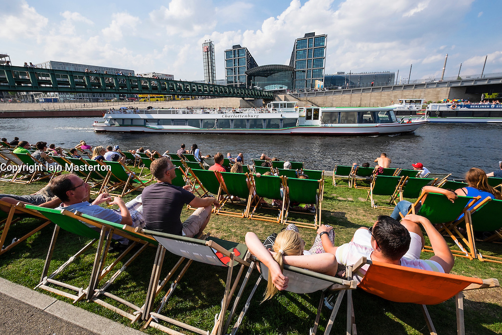 Busy outdoor bar and cafe beside River Spree in Berlin Germany