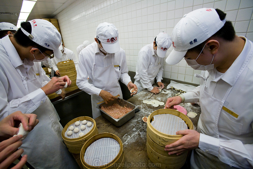 Cooks prepare dumplings to be steamed at a restaurant in Taipei, Taiwan.