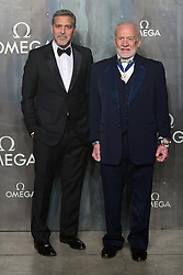 George Clooney (left) and Buzz Aldrin attending the Lost in Space event to celebrate the 60th anniversary of the OMEGA Speedmaster held in the Turbine Hall, Tate Modern, 25 Sumner Street, Bankside, London.