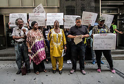 """August 8, 2017 - New York City, New York, United States of America - Headed by Dr. Rev Phil Craig of Al Sharpton's National Action Network, a group of voters from Lefrak City in Queens allege irregularities and attempts to change the demographics of the votes in their district via a closure of their local voting office.  The local office has been open for more than three decades, according to demonstrators.  This is the latest in a series of rallies for """"election integrity"""" that have popped up around the city from unconnected groups.  The protest took place at 42 Broadway, near Wall Street. (Credit Image: © Sachelle Babbar via ZUMA Wire)"""