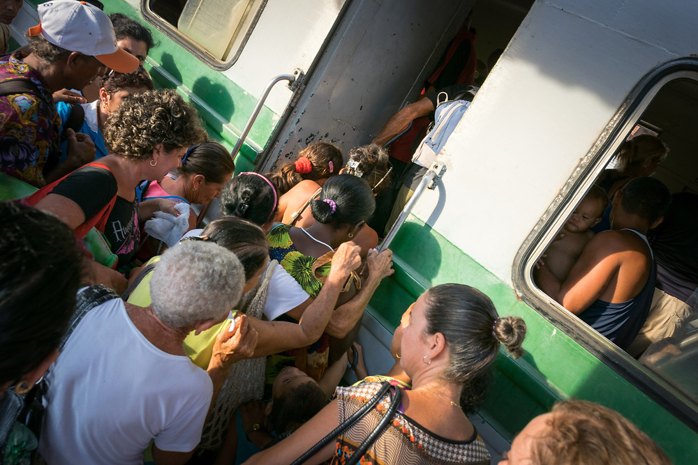 26 September 2015, Trinidad, Cuba: At the train station, the old but functional commuter train picks up passengers before it runs through the countryside villages near Trinidad.