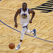 ORLANDO, FL - FEBRUARY 19:  Draymond Green #23 of the Golden State Warriors dribbles the ball against the Orlando Magic during the second half at Amway Center on February 19, 2021 in Orlando, Florida. NOTE TO USER: User expressly acknowledges and agrees that, by downloading and or using this photograph, User is consenting to the terms and conditions of the Getty Images License Agreement. (Photo by Alex Menendez/Getty Images)*** Local Caption ***  Draymond Green